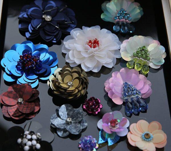 1 PCS Big Sequin Patches Beaded Cloth Flowers DIY Clothing Accessories Sweater Decorated 3D Flower Patch 1 600x530 - دراسة جدوى مشروع محل الكلف وإكسسورات القماش باستثمار 200,000 دولار