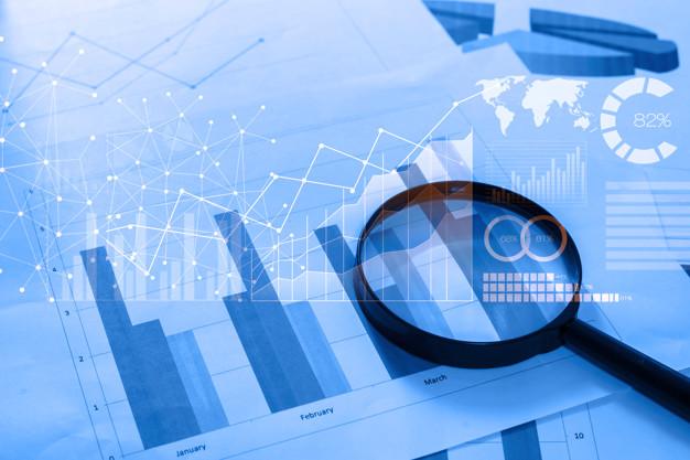 magnifying glass and documents with analytics data lying on table 33799 219 - قواعد الاستثمار الأربعين في أفضل شركة دراسات جدوى في عمان