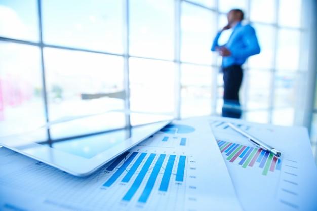 statistic documents with businessman blurred background 1098 293 - أفضل شركة دراسة الجدوى في السعودية